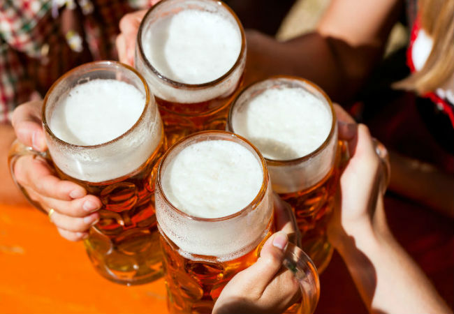 Clinking beers at the Hofbrauhaus | Shutterstock