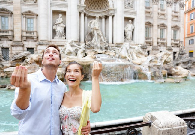 Making a wish at the Trevi fountain | Maridav/Shutterstock