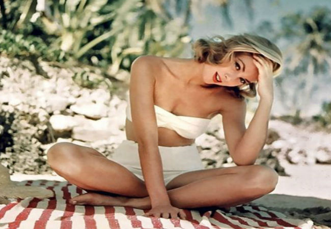 A risque photo shoot as Grace Kelly sports the bikini in the 50's